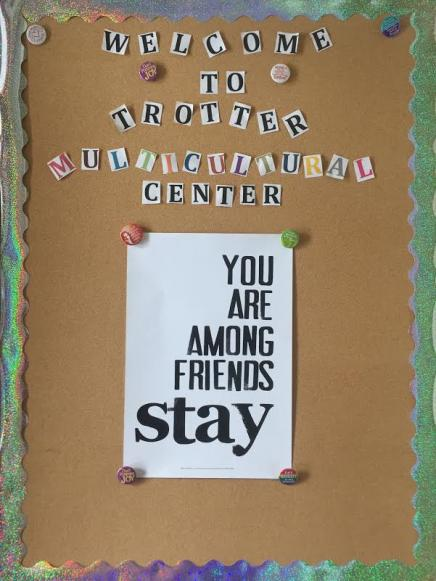 """Picture of welcome posterboard inside Trotter front door; """"You are among friends; stay"""" poster copyright 2012 by Deborah Velasquez; published by New World Graphics"""